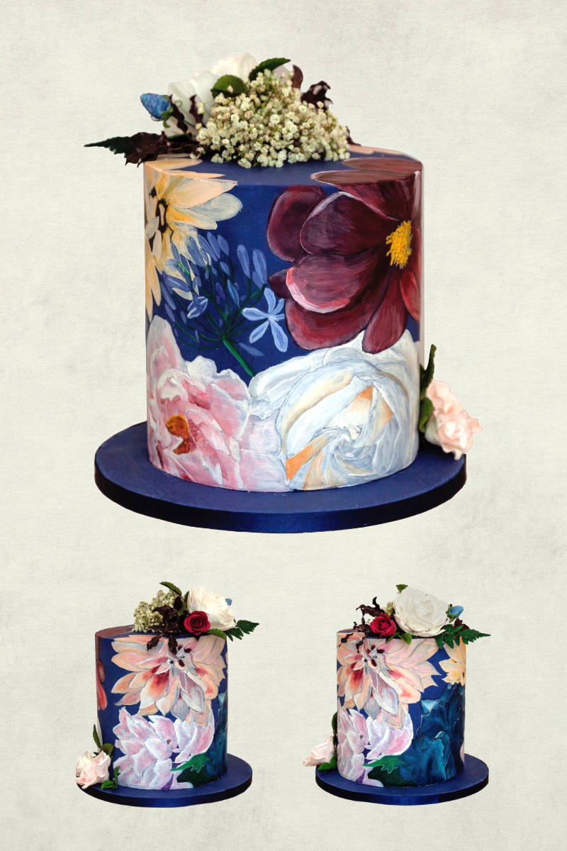 A tall single tier cake decorated with handpainted flowers