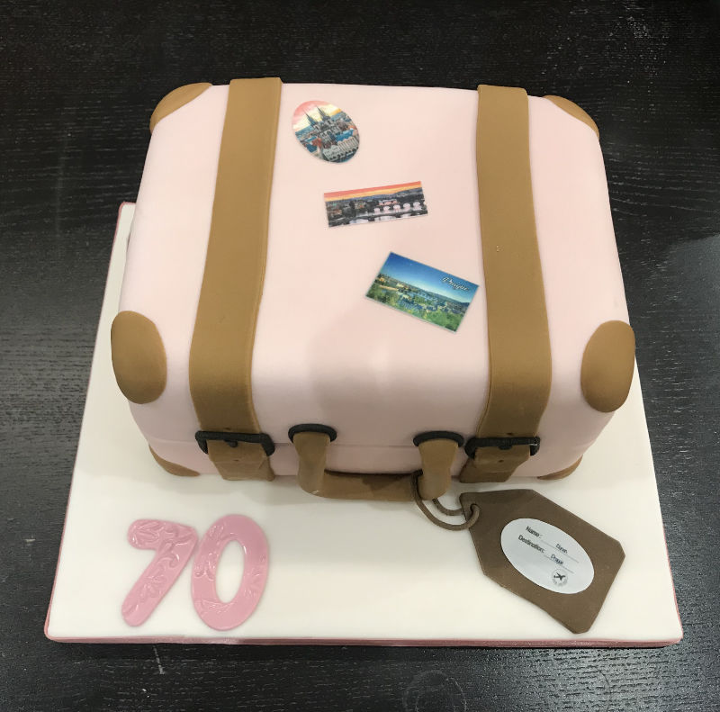 A suitcase shaped fondant cake