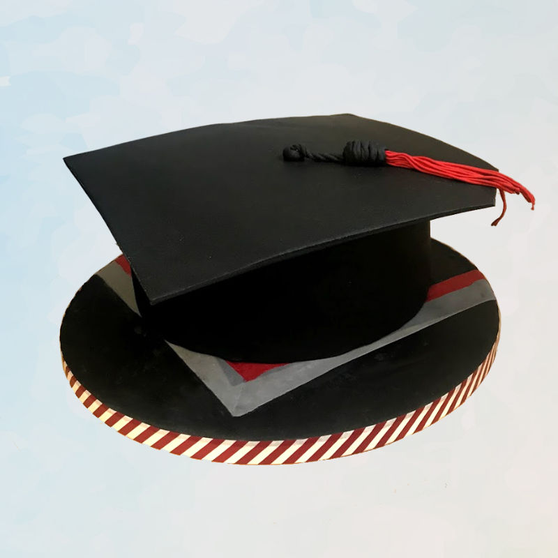 A fondant covered cake shaped like a graduation cap