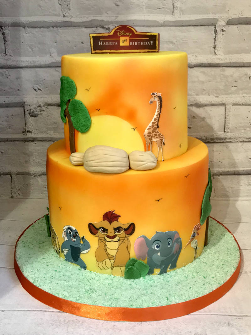 A two tier fondant covered cake themed around the lion guard.